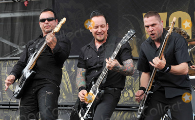 Anders Kjlholm Photo - 20 May 2012 - Columbus OH -  Singerguitarist MICHAEL POULSEN bassist Anders Kjlholm and guitarist HANK SHERMANN of the Danish rock band VOLBEAT performs at Day 2 of the  Rock On The Range Festival held at Crew Stadium Photo Credit Jason L NelsonAdMedia