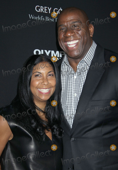 Magic Johnson Photo - 18 March 2013 - Hollywood California - Magic Johnson and Cookie Johnson Olympus Has Fallen Los Angeles Premiere held at ArcLight Cinemas Cinerama Dome Photo Credit Russ ElliotAdMedia