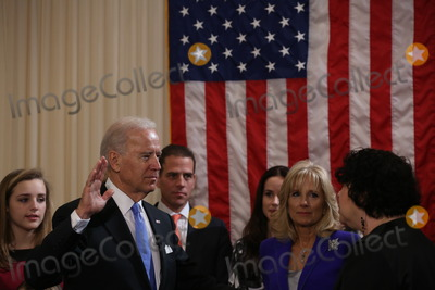 Joseph Biden Photo - United States Vice President Joseph Biden Jr takes the oath of office administered by Associate Supreme Court Justice Sonia Sotomayor in the residence of the Vice President at the United States Naval Observatory in Washington DC on Sunday January 20 2013 Photo Credit Josh HanerCNPAdMedia