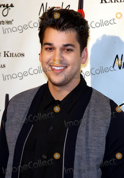 Rob- Kardashian Photo - 15 December 2011 - Las Vegas Nevada - Rob Kardashian   The Kardashian Family celebrates the Grand Opening of Kardashian Khaos at The Mirage Hotel and Casino  Photo Credit MJTAdMedia