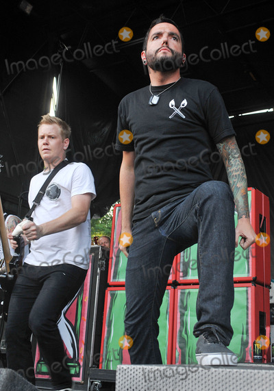 Jeremy McKinnon Photo - 20 July 2011 - Cleveland OH - Vocalist JEREMY KcKINNON and bassist JOSHUA WOODARD of the pop-punk band A DAY TO REMEMBER performs on a stop of the Vans Warped Tour 2011 held at the Blossom Music Center  Photo Credit Jason L NelsonAdMedia