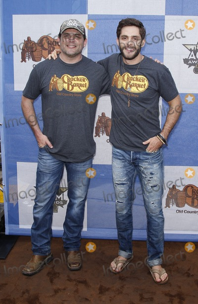 Rhett Akins Photo - 18 April 2015 - Arlington TX -   Rhett Akins Thomas Rhett  Cracker Barrel Country Checkers Challenge at The ACM Party For A Cause at Global Life StadiumPhoto Credit mjtAdMedia