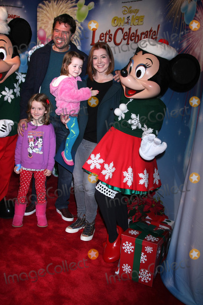 Alexis Denisof Photo - Alyson Hannigan and Alexis Denisof with childrenat Disney On Ice Presents Lets Celebrate Staples Center Los Angeles CA 12-11-14