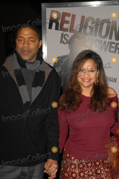 Norm Nixon Photo - Norm Nixon and Debbie Allenat The Book Of Eli Premiere Chinese Theater Hollywood CA 01-11-10