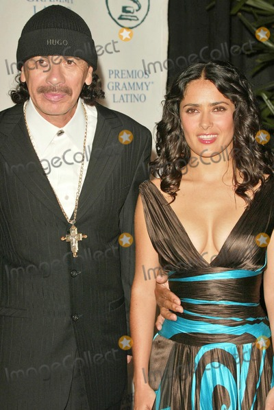Carlos Santana Photo - Carlos Santana and Salma Hayek at the 2004 Latin Recording Academy Person of the Year Tribute to Carlos Santana at the Century Plaza Hotel Century City CA 08-30-04