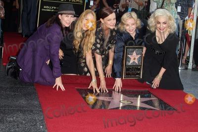 Gina Schock Photo - Kathy Valentine Charlotte Caffey Belinda Carlisle Gina Schock and Jane Wiedlinat the Go-Gos induction into the Hollywood Walk of Fame Hollywood CA 08-11-11
