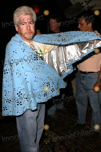 Andy Kaufman Photo - Bob Kerman shows off the cape Andy Kaufman wore on Saturday Night Live at Andy Kaufman Dead Or Alive a party thrown to celebrate the 20 year anniversary (and rumored return) of Andy Kaufmans death House of Blues Hollywood CA 05-16-04