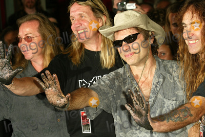 Iron Maiden Photo - Dave Murray and Nicko McBrain with Bruce Dickinson and Steve Harris at the ceremony honoring Iron Maiden with induction in to the Hollywood Rockwalk Rockwalk HollywoodCA 08-19-05