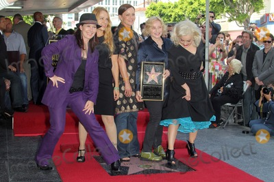 Gina Schock Photo - Kathy Valentine Charlotte Caffey Belinda Carlisle Gina Schock and Jane Wiedlinat the Go-Gos induction into the Hollywood Walk of Fame Hollywood CA 08-11-11