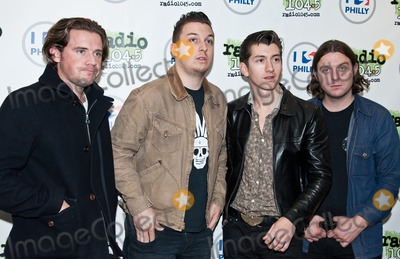 Alex Turner Photo - BALA CYNWYD PA - SEPTEMBER 18  (L to R) Jamie Cook Matt Helders Alex Turner and Nick OMalley of the British Alternative Rock Band Arctic Monkeys Pose at Radio 1045s Performance Theatre on September 18 2013 in Bala Cynwyd Pennsylvania  (Photo by Paul J FroggattFamousPix)