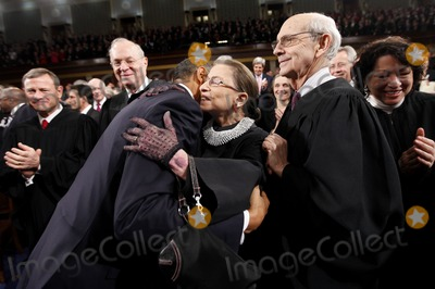 John Roberts Photo - United States President Barack Obama hugs Justice Ruth Bader Ginsburg on Capitol Hill in Washington Tuesday Jan 25 2011 prior to delivering his State of the Union address From left are Chief Justice John Roberts Justice Anthony Kennedy the president Justice Ginsburg and Justice Stephen Breyer  Photo by Pablo Martinez Monsivais PoolCNP-PHOTOlinknet