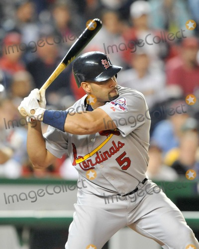 Albert Pujols Photo - Washington DC - April 30 2009 -- St Louis Cardinals first baseman Albert Pujols (5) hit the ball during the game against the Washington Nationals at Nationals ParkDigital Photo by Ron Sachs-CNP-PHOTOlinknet