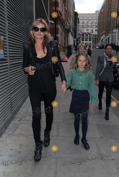 Kate Moss Photo - 8th May 2013  Kate Moss and her daughter Lila Grace Moss attend an exhibition of fashion photographer Debbi Clarks portraits held at the Strand Gallery
