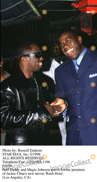 Sean Puffy Combs Photo - Photo by Russ EinhornSTAR MAX Inc - copyright 1998Sean Puffy Combs and Magic Johnson