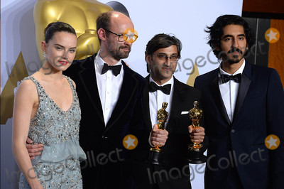 Asif Kapadia Photo - Photo by PDstarmaxinccomSTAR MAXCopyright 2016ALL RIGHTS RESERVEDTelephoneFax (212) 995-119622816Daisy Ridley and Dev Patel present James Gay-Rees and Asif Kapadia with the Academy Award for Best Documentary Feature at the 88th Annual Academy Awards (Oscars)(Hollywood CA USA)