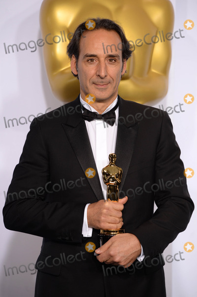 Alexandre Desplat Photo - Photo by PDstarmaxinccomSTAR MAX2015ALL RIGHTS RESERVEDTelephoneFax (212) 995-119622215Alexandre Desplat with the Original Score Award for The Grand Budapest Hotel in the Press Room at the 2015 Oscars held at the Kodak Theatre Hollywood(Los Angeles USA)