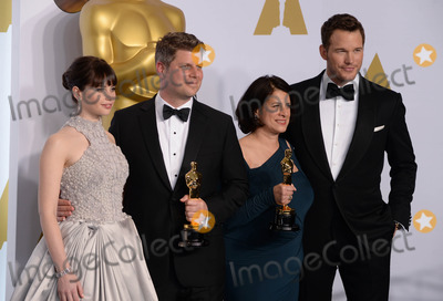 Adam Stockhausen Photo - Photo by PDstarmaxinccomSTAR MAX2015ALL RIGHTS RESERVEDTelephoneFax (212) 995-119622215Anna Pinnock (second right) and Adam Stockhausen (second left) with the award for best production design for The Grand Budapest Hotel alongside presenters Felicity Jones and Chris Pratt in the Press Room at the 2015 Oscars held at the Kodak Theatre Hollywood(Los Angeles USA)