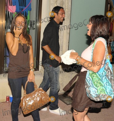 Alessandro Nesta Photo - EXCLUSIVE Italian footballer Alessandro Nesta smiles as his wife Gabriela Pagnozzi (R) laughs with a friend  The pair were out for the night on Lincoln Rd with fellow footballer Paolo Maldini and his wife Adriana Maldini Miami Beach FL  070910 Fees must be agreed prior to publication