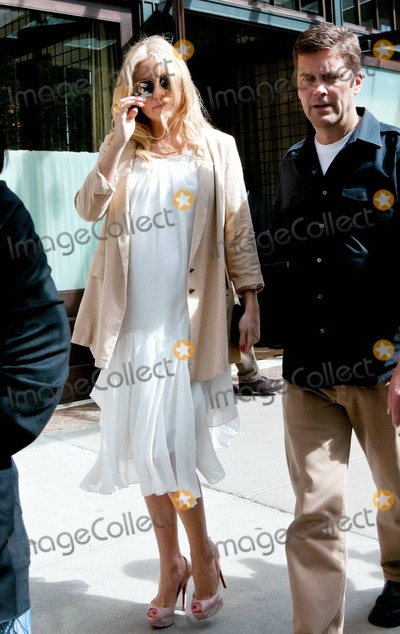 Chris Robinson Photo - With her baby bump showing through her summery white dress actress Kate Hudson leaves her luxury hotel accompanied by security Its reported that earlier today during an interview with Matt Lauer on NBCs Today show Hudson announced that she is engaged to boyfriend and Muse frontman Matthew Bellamy During the interview Lauer admired the huge diamond engagement ring Kate wore asking Is this new Kate responded This is new Hudson said that the engagement happened about a week ago but hadnt really announced it She added Hes a beautiful man and Im very excited calling the proposal very sweet and very romantic  Kate who is reportedly due in mid July has been dating Bellamy since they met at the Coachella festival in April 2010 She currently has a son Ryder with ex-husband Chris Robinson New York NY 42711