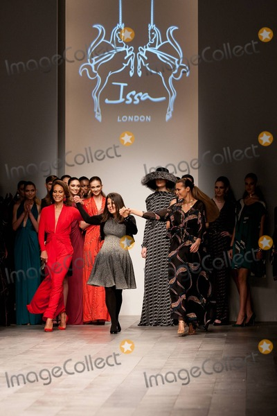 Andrea Dellal Photo - Andrea Dellal and Yasmin Le Bon hold hands with designer Daniella Helayel (C) on the runway at the Issa London runway show during London Fashion Week  Recently sales of Issa London dresses have soared after Prince Williams fiancee Kate Middleton wore an Issa dress on the day the couple announced their engagement London UK 021911