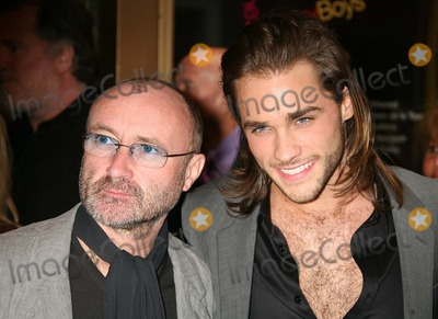 Phil Collins Photo - Phil Collins and Josh Strickland (Star of Disneys Tarzan) Arriving at the Opening Night of the History Boys at the Broadhurst Theatre in New York City on 04-23-2006 Photo by Henry McgeeGlobe Photos Inc 2006