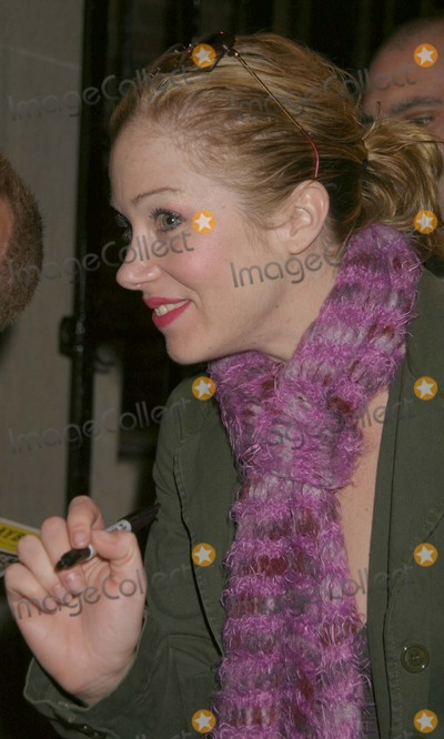 Christina Applegate Photo - NYC  041805Christina Applegate (wearing a scarf and a army green coat with a heart on the back) signing autographs after her Broadway debut in SWEET CHARITY at the Al Hirschfeld TheatreDigital Photo by Adam Nemser-PHOTOlinkorg