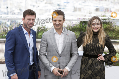 Jeremy Renner Photo - CANNES FRANCE - MAY 20 Director Taylor Sheridan Jeremy Renner and Elizabeth Olsen attend the Wind River photocall during the 70th annual Cannes Film Festival at Palais des Festivals on May 20 2017 in Cannes France(Photo by Laurent KoffelImageCollectcom)