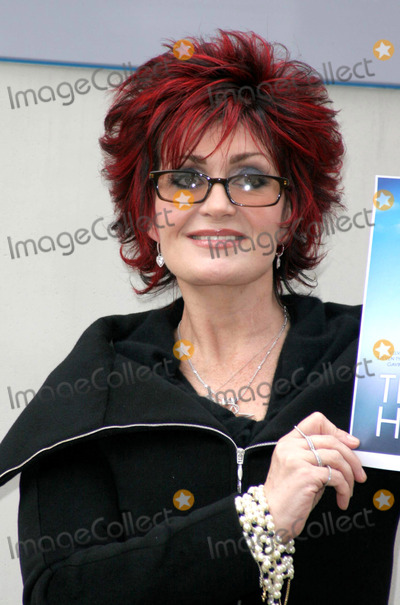 Phil Collins Photo - LONDON JANUARY 21 2005    Sharon Osbourne at a news conference for the Tsunami Charity single which is a cover of Eric Claptons Tears in Heaven The charity single has contributions so far from Sir Elton John Velvet Revolver and Andrea Bocelli Next week Rod Stewart Phil Collins Ozzy and Kelly Osbourne Gwen Stefani and Gavin Rossdale Aerosmiths Steven Tyler Pink Josh Groban and Robert Downey Jr are to lay down vocals at a further recording session in LA