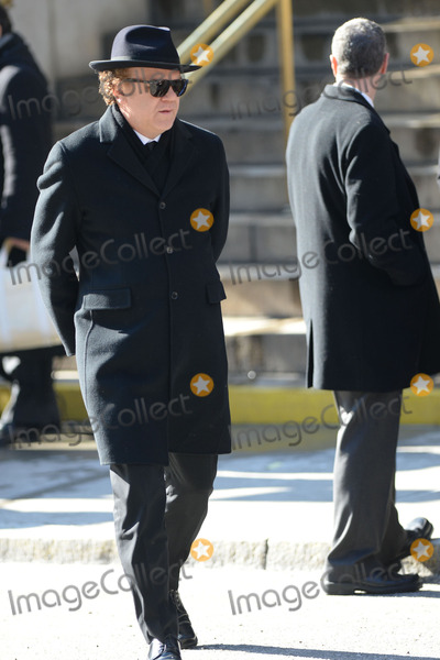 Philip Seymour Hoffman Photo - February 7 2014 New York CityJohn C Reilly attending Philip Seymour Hoffmans funeral at St Ignatius Loyola Church in Manhattan on February 7 2014 in New York City