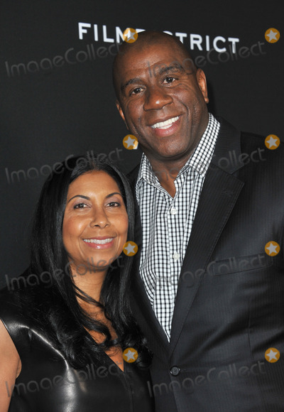 Magic Johnson Photo - Earvin Magic Johnson  wife Cookie at the Los Angeles premiere of Olympus Has Fallen at the Cinerama Dome HollywoodMarch 18 2013  Los Angeles CAPicture Paul Smith  Featureflash
