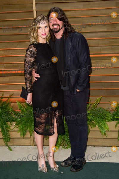 Dave Grohl Photo - Dave Grohl and wife Jordyn Blum arriving for the 2014 Vanity Fair Oscars Party Los Angeles 02032014 Picture by James McCauleyFeatureflash