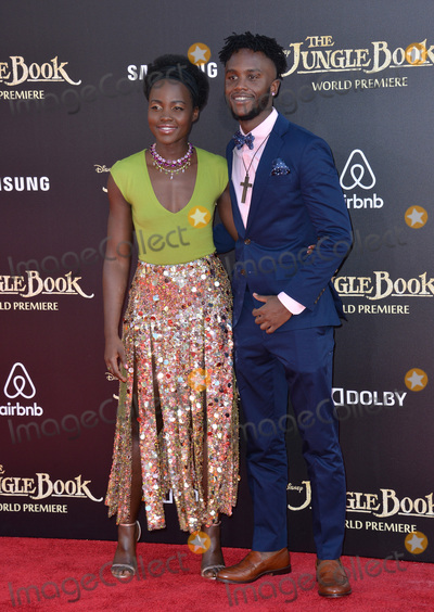 Lupita Nyongo Photo - LOS ANGELES CA April 4 2016 Actress Lupita Nyongo  brother Peter Nyongo at the world premiere of The Jungle Book at the El Capitan Theatre HollywoodPicture Paul Smith  Featureflash