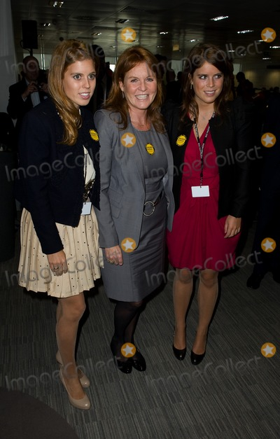 911 Photo - Sarah Ferguson Princess Beatrice and Princess Eugenie take to the trading floor at BGC in Canary Wharf as part of the fundraising day set up after the 911 terrorist attacks 12092011 Picture by Simon Burchell  Featureflash