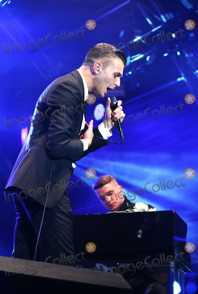 Adam Anderson Photo - London UK Theo Hutchcraft and Adam Anderson of Hurts performing at Somerset House in London 14th July 2011 Justyna SankoLandmark Media