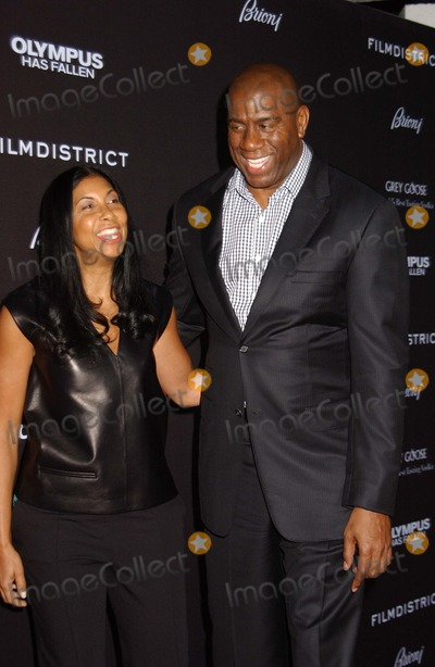 Magic Johnson Photo - Magic Johnson  Wife Attend the Premiere of Olympus Has Fallenat the Chinese Theater in Hollywoodca on March 182013 Photo by Phil Roach-ipol-Globe Photos