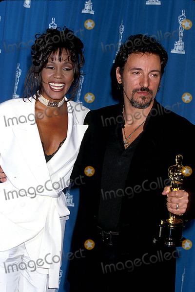 Bruce Springsteen Photo - Sd0321 66th Annual Academy Awards  Photo Michael Furguson Globe Photos Inc 1994 Whitney Houstn  Bruce Springsteen Whitneyhoustonretro
