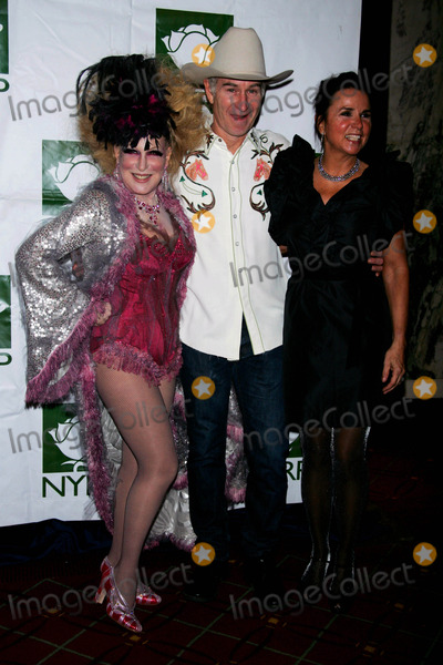 Bette Midler Photo - Bette Midler and John Mcenroe and Wife Patty Smyth Arrive For the Hulaween Gala at the Waldorf Astoria in New York on October 30 2009 Photo by Sharon NeetlesGlobe Photos Inc