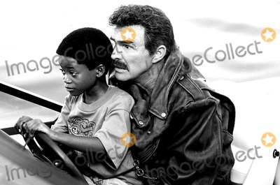 Burt Reynolds Photo - Burt Reynolds and Norman D Golden Ii in a Scene From Cop and a Half A10537 Supplied by RangefindersGlobe Photos Inc