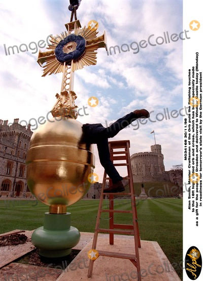 Alan Smith Photo - M034168 301198Alan Smith Master Craftsman of the Orb puts the finishing touches to the 18ft high gilded orb and cross which has been specially made as a gift for the people of Dresden and delivered to Windsor Castle today (Monday) in readiness for tomorrows state visit by the German president