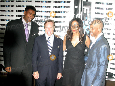 Alan Houston Photo - the 5th Annual Gala Awards Ceremony For the  National Black Sports and Entertainment Hall of Fame  at the Aaron Davis Hall in Harlem  New York City 08-30-2005 Photo Byrick Mackler-rangefinders-Globe Photos 2005 Alan Houston and Tommy Hilfiger