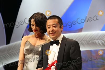 Asia Argento Photo - Actress Asia Argento and Best Screenplay Winner Jia Zhangke Attend the Closing Ceremony During the 66th Cannes International Film Festival at Palais Des Festivals in Cannes France on 26 May 2013 Photo Alec Michael Photo by Alec Michael - Globe Photos Inc