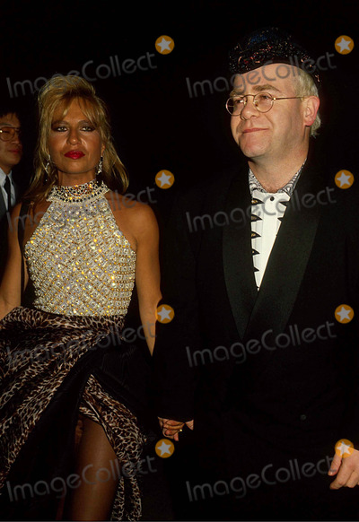 Elton John Photo - Elton John with Danatella Versace 1990 15827 Photo by Phil Roach-ipol-Globe Photos Inc