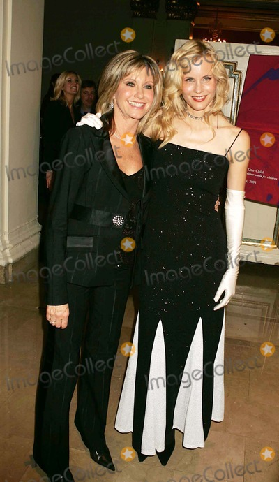 Olivia Newton-John Photo - Tribute to Olivia Newton-john at the  One World One Child  Benefit at the Plaza Hotel in New York City 11112004 Photo Byrick MacklerrangefindersGlobe Photos Inc 2004 Olivia Newton-john and Lori Singer