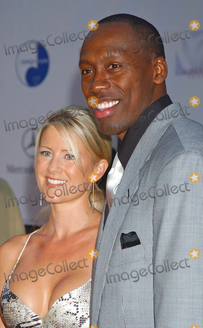 Al Joyner Photo - 6th Annual Mercedes Benz Designcure at the Home of Sugar Ray Leonard in Pacific Palisades CA 07102004 Photo by Miranda ShenGlobe Photos Inc 2004 AL Joyner and Wife Alisha