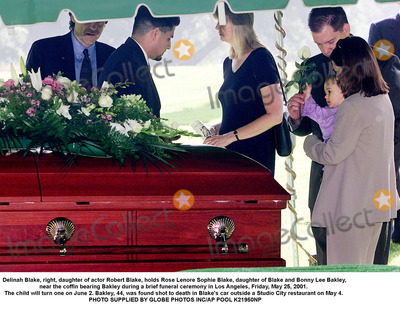 Sophie Blake Photo - Delinah Blake right daughter of actor Robert Blake holds Rose Lenore Sophie Blake daughter of Blake and Bonny Lee Bakley near the coffin bearing Bakley during a brief funeral ceremony in Los Angeles Friday May 25 2001  The child will turn one on June 2 Bakley 44 was found shot to death in Blakes car outside a Studio City restaurant on May 4  PHOTO SUPPLIED BY GLOBE PHOTOS INCAP POOL K21950NP