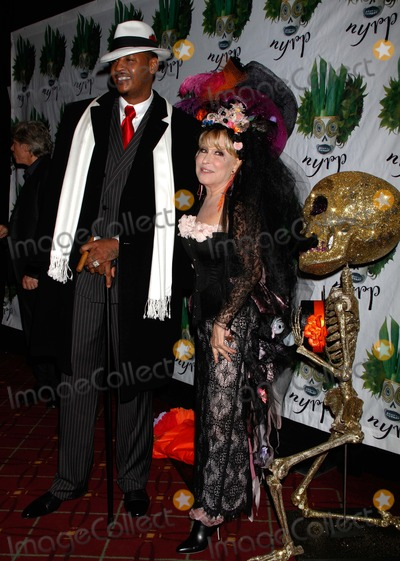 Carmelo Anthony Photo - Carmelo Anthony and Bette Midler Arrive For Bette Midlers Hulaween Gala at the Waldorf Astoria in New York on October 28 2011 Photo by Sharon NeetlesGlobe Photos Inc