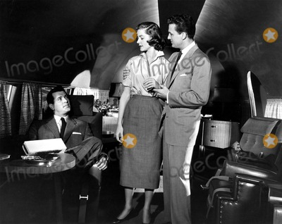 Rock Hudson Photo - Rock Hudson Lauren Bacall and Robert Stack in Written on the Wind 1956 Supplied by Globe Photos Inc Robertstackretro