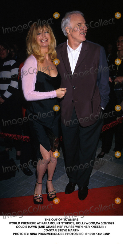 Goldie Photo - 032999 the Out-of-towners World Premiere at Paramount Studios Hollywood CA Goldie Hawn (She Grabs Her Purse with Her Knees) and Co-star Steve Martin Photo by Nina PrommerGlobe Photos Inc