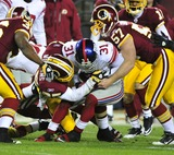 Aaron Ross Photo - RESTRICTED NO NEW YORK OR NEW JERSEYNEWSPAPERS WITHIN A 75 MILE RADIUS OF NYC01022011 - GIANTS V REDSKINSNew York Giants punt returner Aaron Ross (31) is tackled in the third quarter against the Washington Redskins at FedEx Field in Landover Maryland on Sunday January 2 2011  The Giants won 17 - 14Photo by Ron SachsCNP-PHOTOlinknet