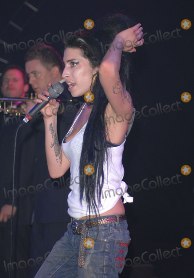 Amy Winehouse Photo - Amy Winehouse performs live at G-A-YAt the the gig Promoter Jeremy Joseph offers Amy Champagne or Flowers Amy replies I dont drink and grabs the flowersG-A-Y The Astoria LondonApril 14 2007Photo by RobertStarimages